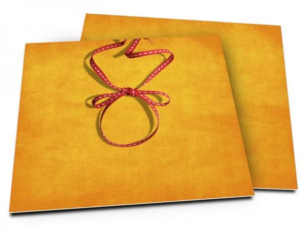Faire-part mariage - Noeud rouge sur fond orangé