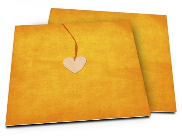 Faire-part mariage - Pendentif sur fond jaune-orangé